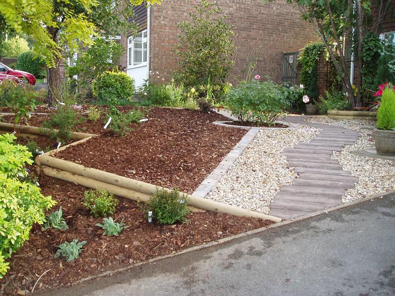 Front sloping garden for Garden designs for sloping gardens